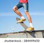 cool skateboard is jumping high ... | Shutterstock . vector #384449650