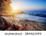 beautiful sunset on ocean beach ... | Shutterstock . vector #384461494