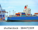 container stack and cargo ship... | Shutterstock . vector #384472309
