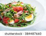 fresh salad with tuna  tomatoes ... | Shutterstock . vector #384487660