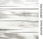 wooden grey polished background | Shutterstock . vector #384541456