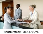 Stock photo businessman check in at hotel reception 384571096
