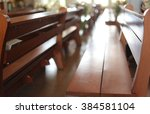 Empty Wooden Bench On The Church