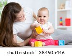 mother and baby girl playing... | Shutterstock . vector #384605446