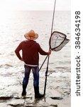 picture of fisherman  | Shutterstock . vector #384634198