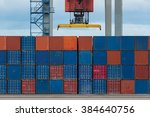 cargo containers at shipyard | Shutterstock . vector #384640756