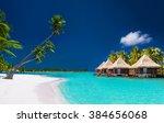 beach villas on a tropical... | Shutterstock . vector #384656068