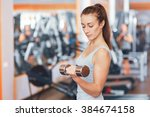 strong woman weightlifting at... | Shutterstock . vector #384674158