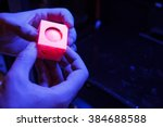 hands holding a figure of a... | Shutterstock . vector #384688588