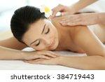 masseur doing massage on woman...   Shutterstock . vector #384719443
