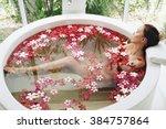 woman relaxing in round outdoor ...   Shutterstock . vector #384757864