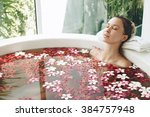 Woman Relaxing In Round Outdoo...