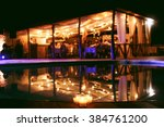 tent restaurant at night on the ... | Shutterstock . vector #384761200