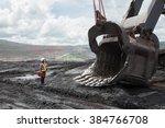 mining engineer in lignite mine | Shutterstock . vector #384766708