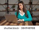beautiful freelancer is working ... | Shutterstock . vector #384948988