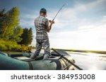 Mature Man Fishing On The Lake...