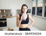 woman in sportswear  drinking... | Shutterstock . vector #384954034