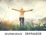 woman traveler hands raised... | Shutterstock . vector #384966838