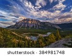 Small photo of Tantalizing barren mountain, azure river zigzag-ing through the lush forest, wispy clouds