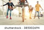 group of active teenagers in... | Shutterstock . vector #385002694