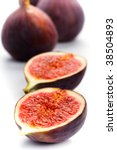 fresh figs closeup on white... | Shutterstock . vector #38504893