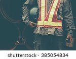 man holding blue helmet close up | Shutterstock . vector #385054834