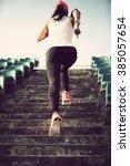 runner athlete running on... | Shutterstock . vector #385057654