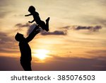 father and son playing on the... | Shutterstock . vector #385076503