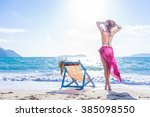 girl on a tropical beach with a ... | Shutterstock . vector #385098550