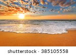colorful ocean beach sunrise. | Shutterstock . vector #385105558
