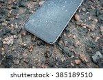 phone with broken screen on... | Shutterstock . vector #385189510