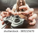Small photo of Addiction and dependency concept. Young man with pad joystick playing games. Male addicted to console playstation videogames.