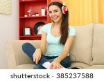happy young woman with... | Shutterstock . vector #385237588