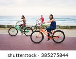 siblings happily cycling... | Shutterstock . vector #385275844