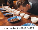 rows of cups and beans with...   Shutterstock . vector #385284124