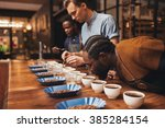baristas training with variety... | Shutterstock . vector #385284154