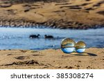 Crystal Balls On The Beach River