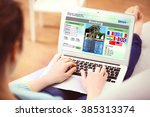 woman using laptop to book... | Shutterstock . vector #385313374