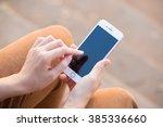 beautiful young woman's hand... | Shutterstock . vector #385336660
