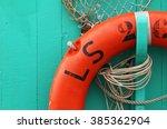 Orange Life Buoy On A Boat