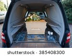 a coffin in a mourning car with ... | Shutterstock . vector #385408300