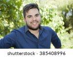 happy young casual man outdoor... | Shutterstock . vector #385408996