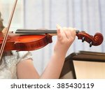 little girl playing the violin | Shutterstock . vector #385430119