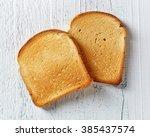 Slices Of Toast Bread On Woode...