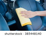 hand cleaning the car interior... | Shutterstock . vector #385448140