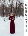Small photo of Bride portrait. Winter. Claret dress