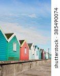 A Row Of Colourful Beach Huts...