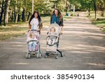 young mother walking with her...   Shutterstock . vector #385490134