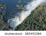 victoria falls and rainbow in...   Shutterstock . vector #385492384