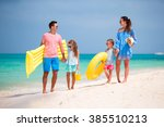 young family on vacation | Shutterstock . vector #385510213